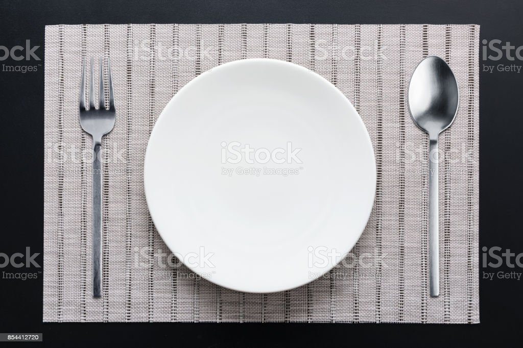 Dinner white plate setting top view with silver fork and spoon royalty-free stock photo & Dinner White Plate Setting Top View With Silver Fork And Spoon Stock ...