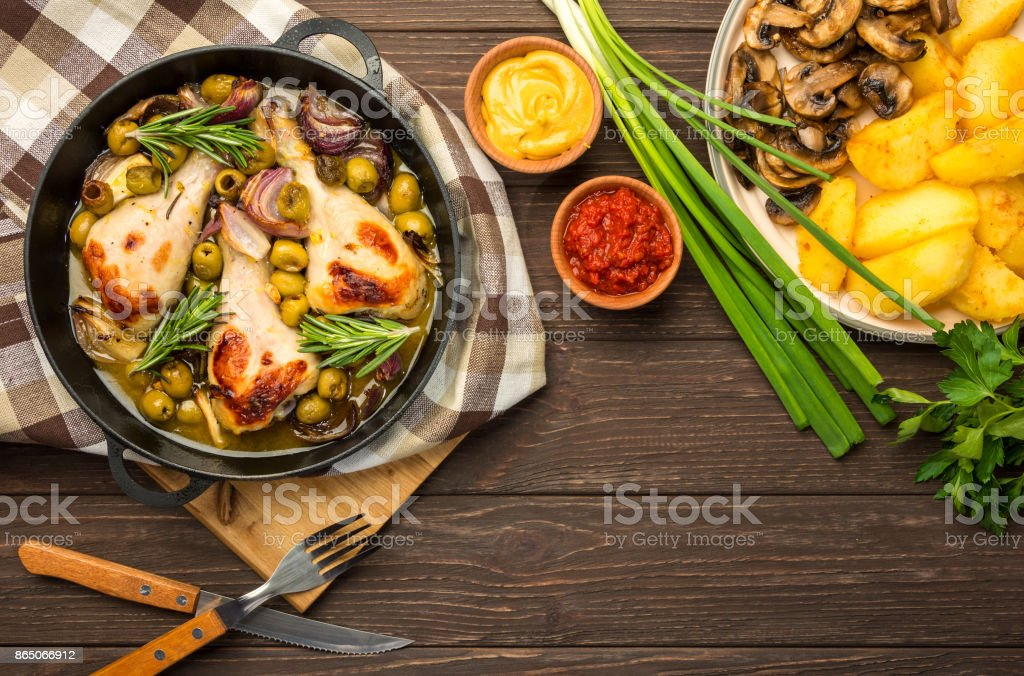 Dinner with baked chicken legs and vegetable. stock photo