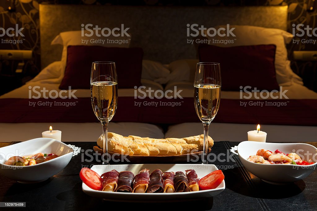 Dinner with champagne in the bedroom royalty-free stock photo