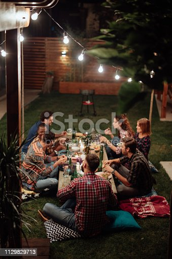 istock Dinner with friends 1129829713