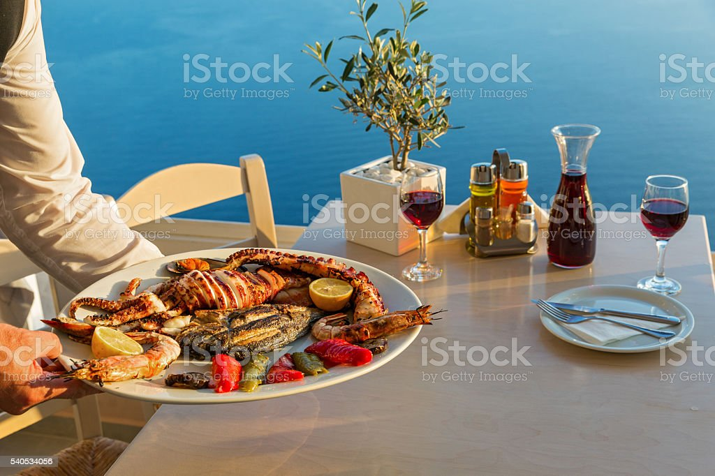 Dinner with seafood and red wine stock photo