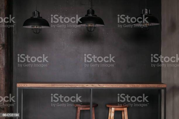 Dinning table set in loft style dining room with black lamps picture id664203194?b=1&k=6&m=664203194&s=612x612&h= 2e1sphobuwtuu10u8r6zdfm3rsbc qdgltnh ophck=