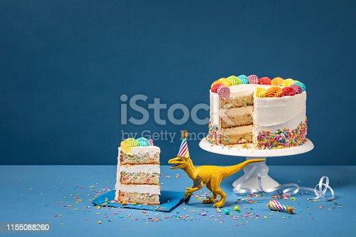 istock Dinosaur and Birthday Cake 1155088260
