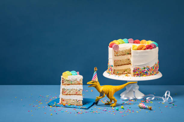 Dinosaur and Birthday Cake stock photo