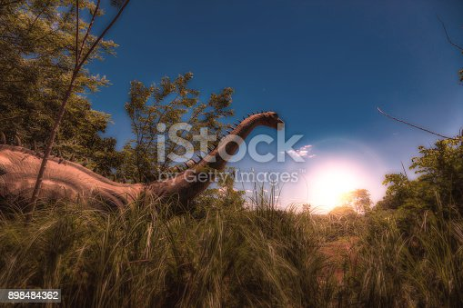 istock Dinosaur in Tall Grass at Sunrise - Photoshop Compositing 898484362