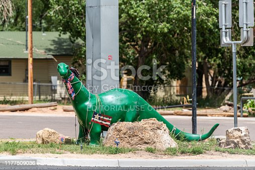Manila, USA - July 24, 2019: Dinosaur sculpture in Sinclair gas station in city near Flaming Gorge Utah National Recreational Area Park near Wyoming border side