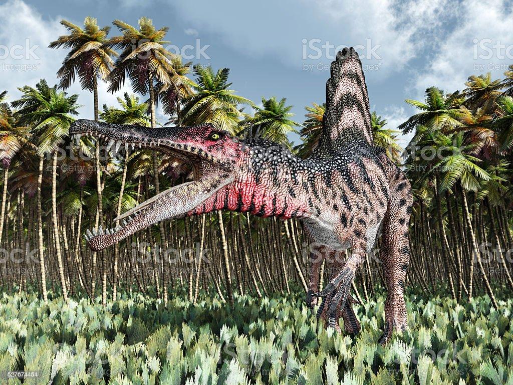 Dinosaur Spinosaurus in the jungle stock photo