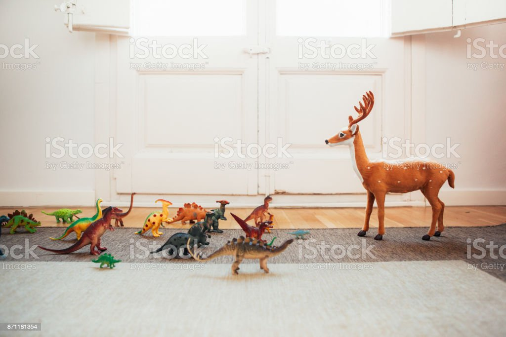 Dinosaurs and reindeer stock photo