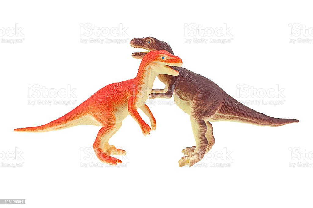 Dinosaurs are fighting on plastic toy isolated on white backgrou stock photo