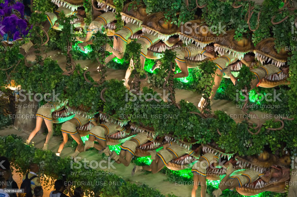Dinosaurs eating people stock photo