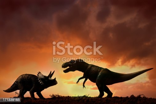 Dinosaurs fight in nature.