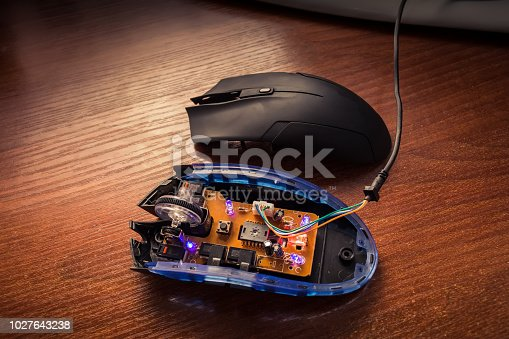 688535966 istock photo diodes glow on an exploded computer mouse 1027643238