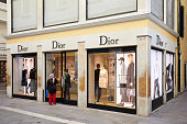 Venice, Italy - August 12, 2017: Dior store with large windows and people in Venice, Italy