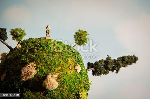 Diorama depicting a hiker on a miniature earth