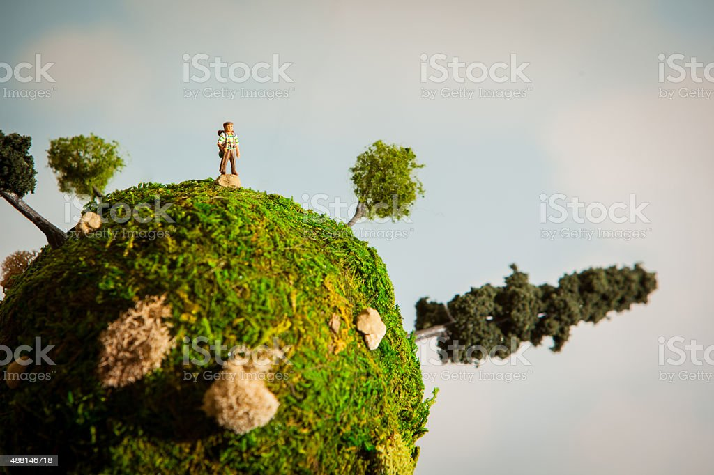 Diorama depicting a hiker on a miniature earth stock photo