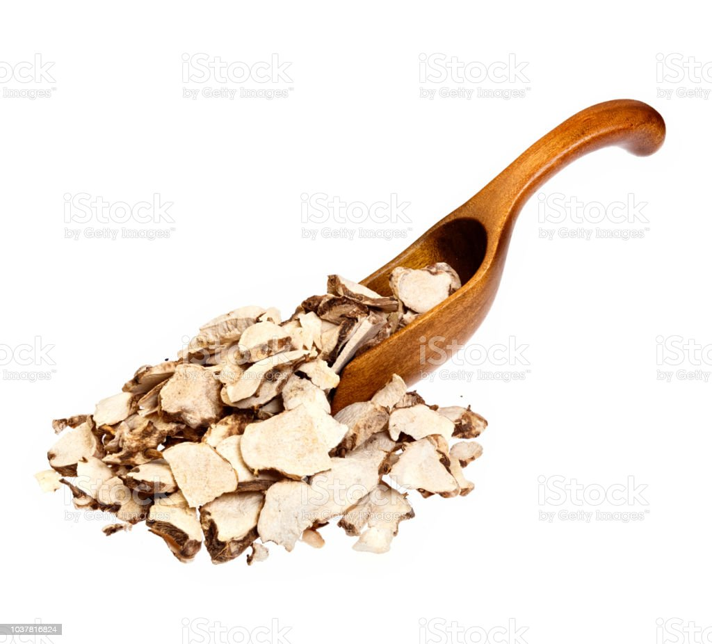 Dioscorea caucasica Angelica sinensis or Female Ginseng on wooden spoon. High resolution photo. stock photo