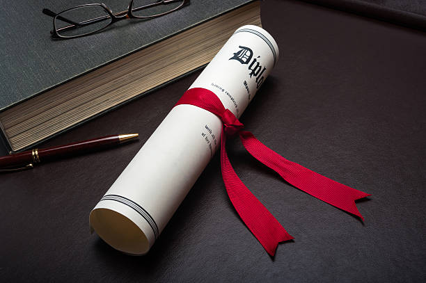 Diploma on a desk stock photo