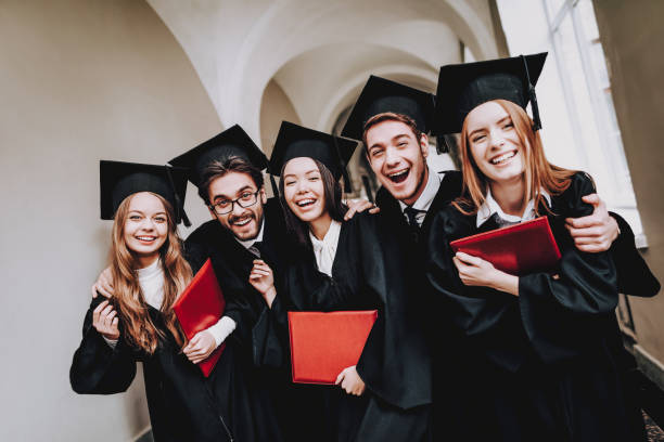 Diploma. University.Students. Friendship. Mantles. stock photo