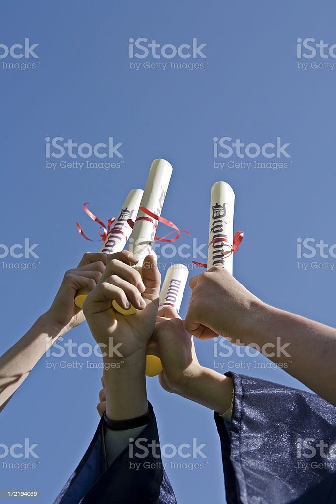 Diplomas against clear blue sky royalty-free stock photo