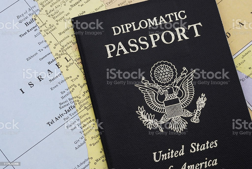 Diplomatic passport on map of Israel stock photo