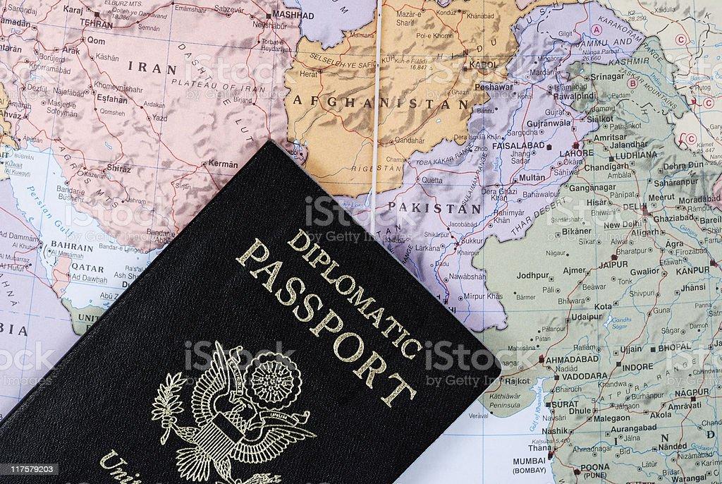 Diplomatic Passport on map stock photo