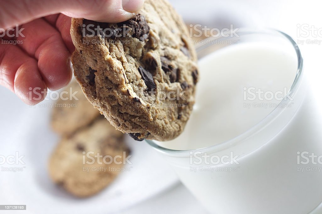 Dipping cookie royalty-free stock photo