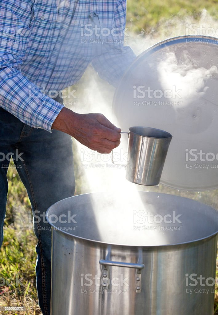 Dipping Cup and Hot Water for Cowboy Coffee stock photo