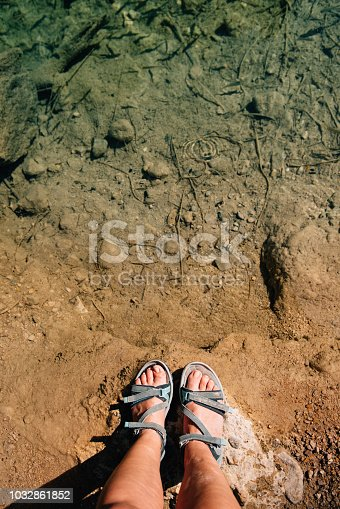 522909925 istock photo Dipping feet in fresh water 1032861852