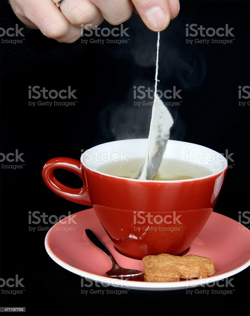 Dipping green tea into a cup royalty-free stock photo
