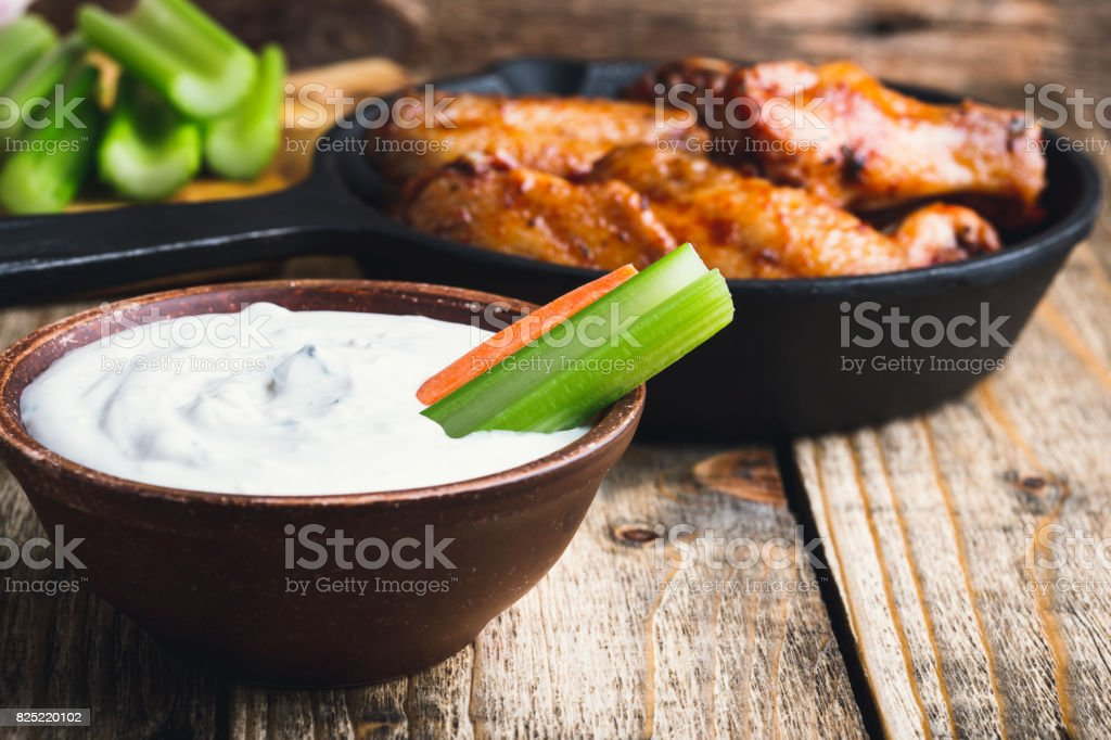 Dipping sauce with roasted chicken wings stock photo