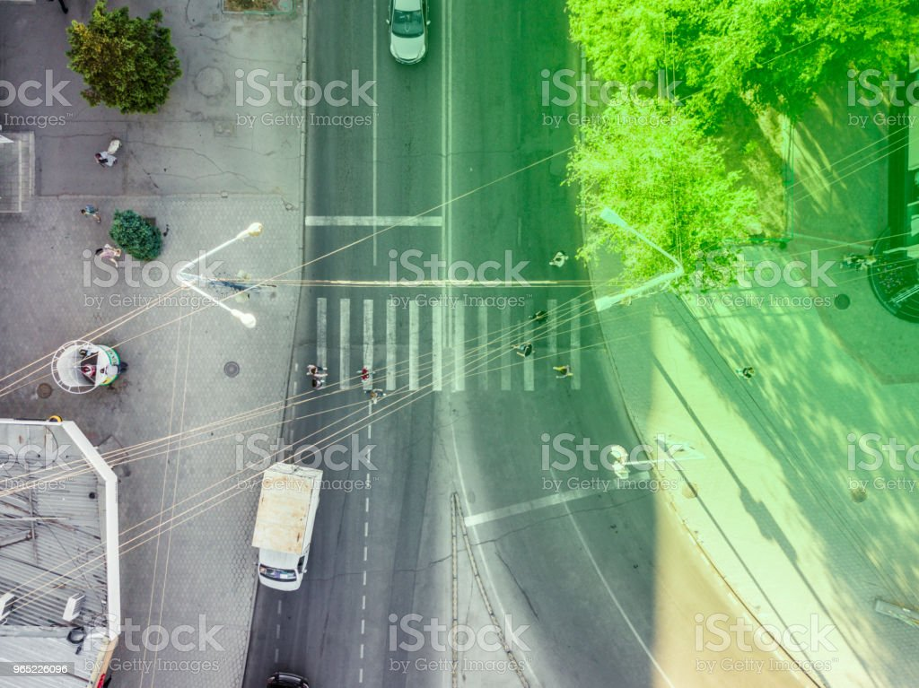 dirctly above view of people walking across the street on a crosswalk royalty-free stock photo