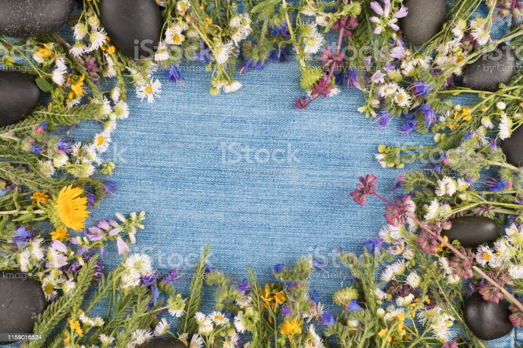Direct View Denim Background In The Center Wild Flowers On