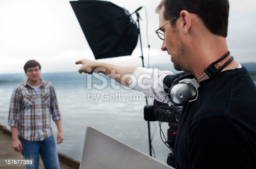 A director communicates with an actor in preparation for a scene.