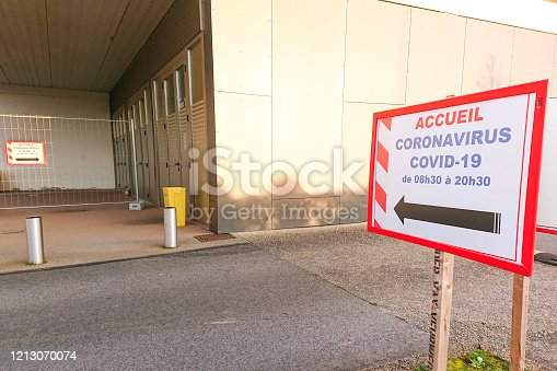 direction sign to indicate the reception and opening hours for patients affected by coronavirus in front of a french hospital to be treated