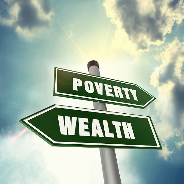 Direction of wealth or poverty stock photo