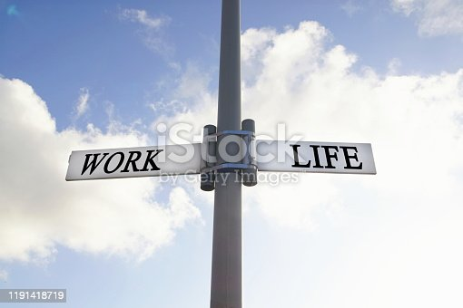 182362845 istock photo direction road sign with work and life words. Life balance choices signpost 1191418719