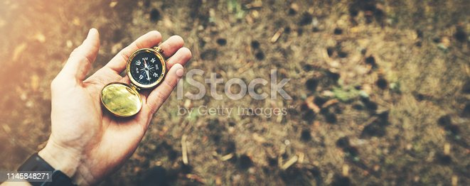direction search exploration concept - compass in hand