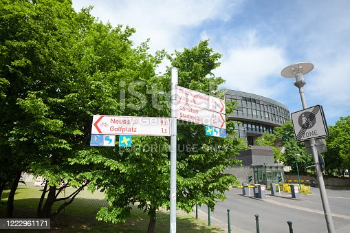 Direction signs in front of parliament Landtag of NRW in Duesseldorf. View from position close to driveway to Parliemant.