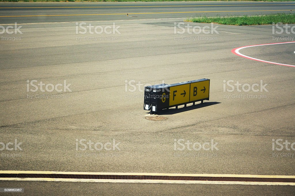 direction signs on an airport taxiway stock photo