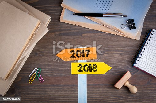 istock direction signs with arrows and the numbers 2017 and 2018, concept for turn of the year 878620068