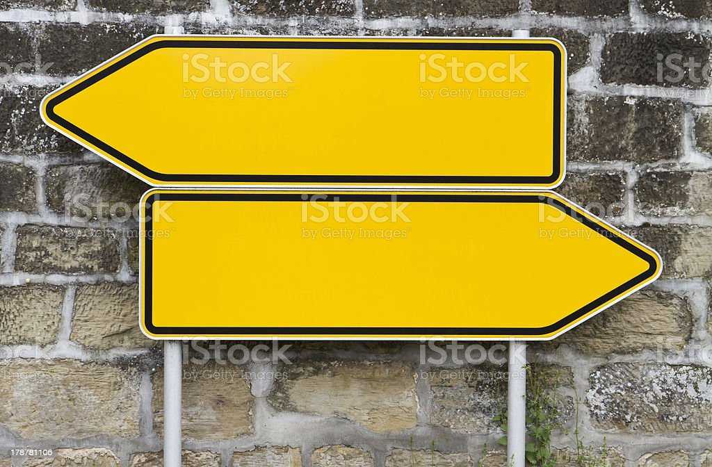 direction signs with wall in background stock photo