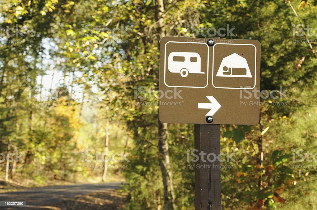 Directional sign for trailer and tent camping royalty-free stock photo