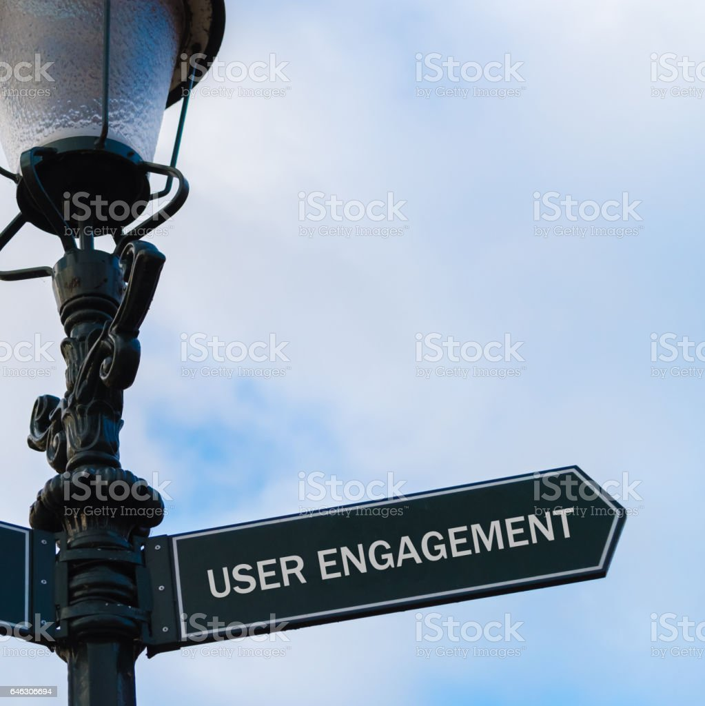USER ENGAGEMENT directional sign on guidepost stock photo