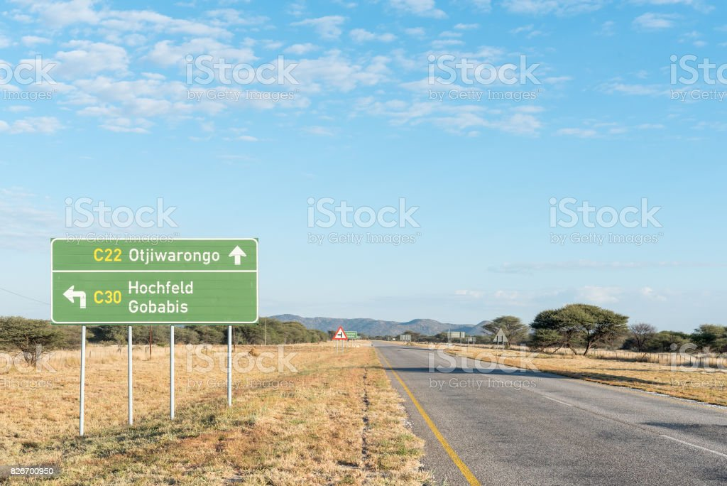 Directional sign on the C22-road stock photo