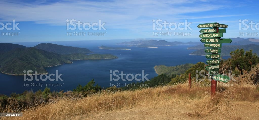 Directional sign on the Oueen Charlotte Trail, Marlborough Sounds. Hiking route in New Zealand. stock photo