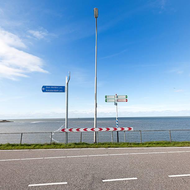 directional signs on Afsluitdijk The Netherlands foto