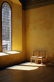 istock Directional sunlight through a leaded glass window. 1077797196
