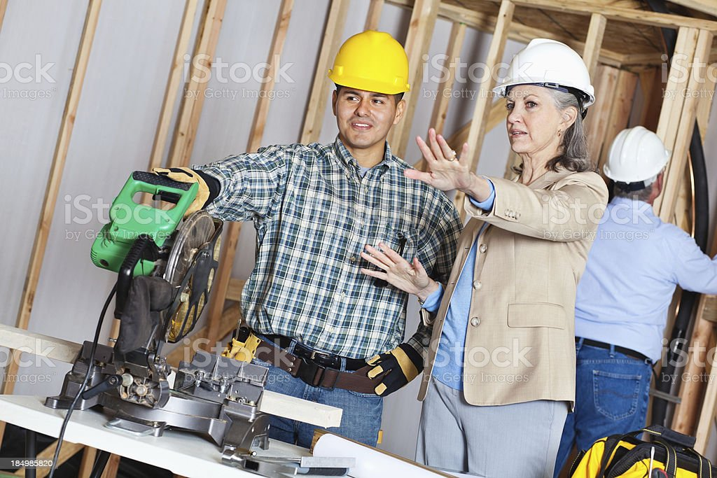 Directions being given to construction worker at new home build royalty-free stock photo