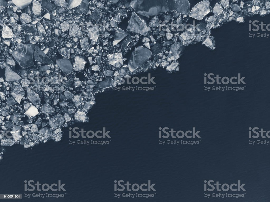 Top down view of a frozen lake on a winter day in Sweden. Shot from...