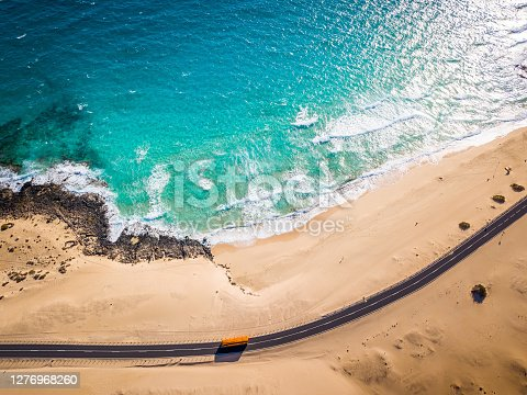 istock Directly above bus road and beach at Corralejo sand dunes, Fuerteventura, Canary 1276968260